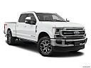 2020 Ford F-250 SD Lariat, front passenger 3/4 w/ wheels turned.