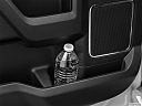 2020 Ford F-250 SD Lariat, second row side cup holder with coffee prop, or second row door cup holder with water bottle.