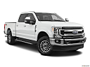 2020 Ford F-350 SD XLT, front passenger 3/4 w/ wheels turned.