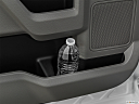 2020 Ford F-350 SD XLT, second row side cup holder with coffee prop, or second row door cup holder with water bottle.
