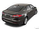 2020 Ford Fusion Hybrid SE, rear 3/4 angle view.