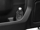 2020 GMC Sierra 2500HD SLT, second row side cup holder with coffee prop, or second row door cup holder with water bottle.