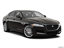 2020 Jaguar XF 30t Prestige, front passenger 3/4 w/ wheels turned.