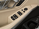2021 BMW 3-series 330i, driver's side inside window controls.