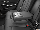 2021 BMW 3-series 330e, rear center console with closed lid from driver's side looking down.