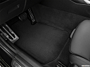 2021 BMW 3-series 330e, driver's floor mat and pedals. mid-seat level from outside looking in.