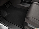 2021 Honda Odyssey LX, driver's floor mat and pedals. mid-seat level from outside looking in.