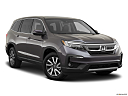 2021 Honda Pilot EX-L, front passenger 3/4 w/ wheels turned.