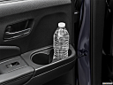 2021 Honda Pilot EX-L, second row side cup holder with coffee prop, or second row door cup holder with water bottle.