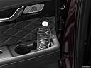 2021 Hyundai Palisade Limited, second row side cup holder with coffee prop, or second row door cup holder with water bottle.