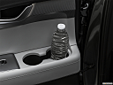 2021 Hyundai Palisade SEL, second row side cup holder with coffee prop, or second row door cup holder with water bottle.