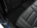 2021 Jeep Grand Cherokee Limited, rear driver's side floor mat. mid-seat level from outside looking in.