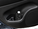 2021 Jeep Grand Cherokee Limited, second row side cup holder with coffee prop, or second row door cup holder with water bottle.